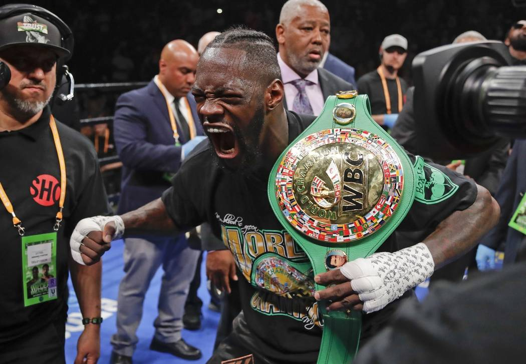 Deontay Wilder poses for photographers after his win in the WBC heavyweight championship boxing ...