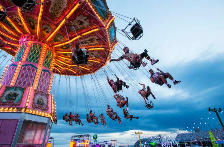 Attendees enjoy a carnival ride during the second day of the Electric Daisy Carnival at the Las ...