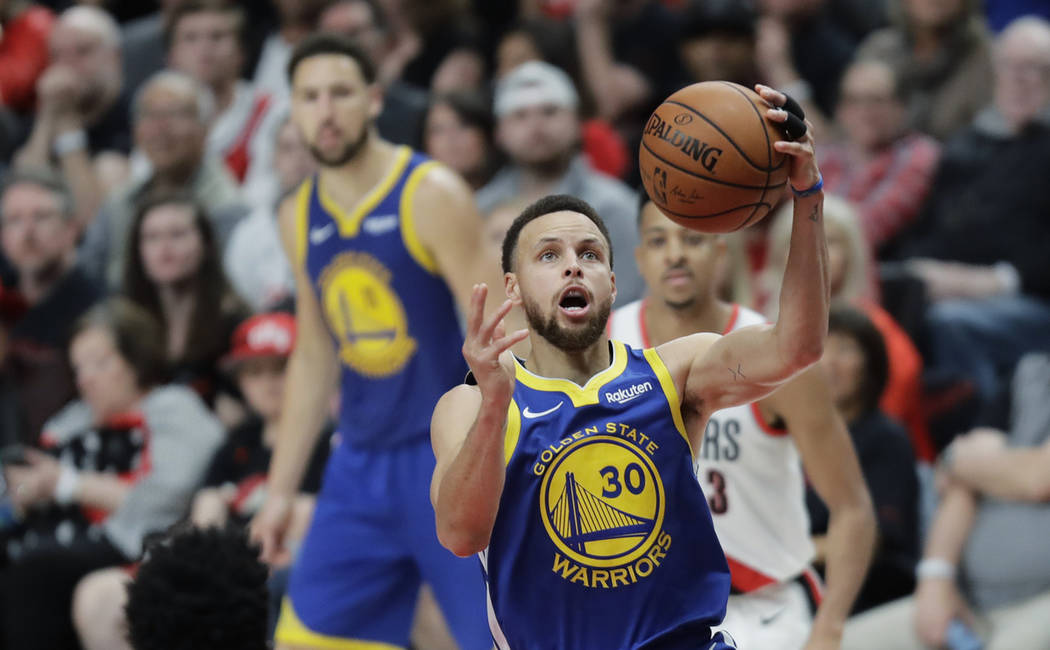 Golden State Warriors guard Stephen Curry shoots during the second half of Game 3 of the NBA ba ...
