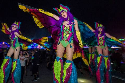 Electric Ladyland Stilt Walkers make their way down Rainbow Road during day two of Electric Dai ...