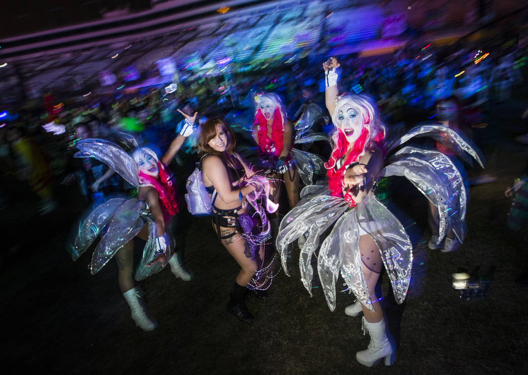 Durann Grijalva, of Las Vegas, dances by the Cosmic Meadow with costumed performers during the ...