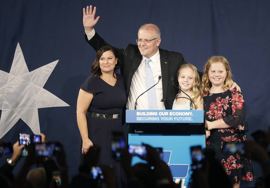 Australian Prime Minister Scott Morrison, second left, arrives on stage to speak to party suppo ...