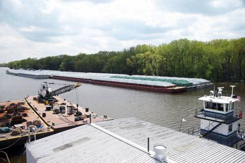 In this Tuesday, May 14, 2019 photo, barges already loaded with soy beans, potash or scrap stee ...