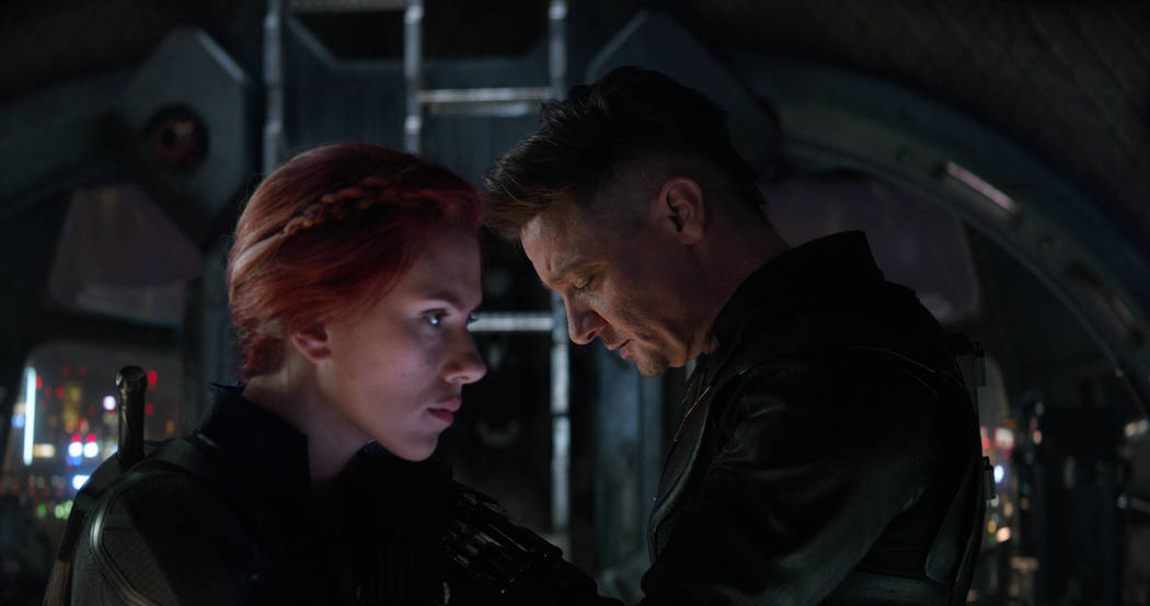 This image released by Disney shows Scarlett Johansson, left, and Jeremy Renner in a scene from ...