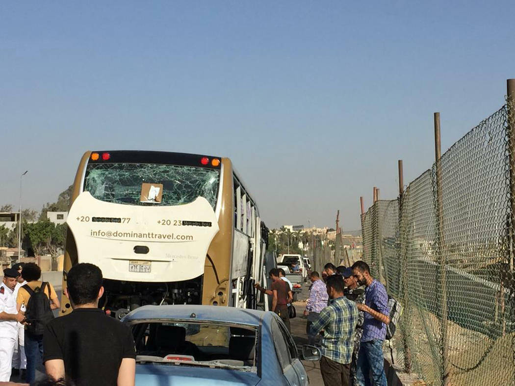 A bus and a car are parked after being damaged by a bomb, in Cairo, Egypt, Sunday, March 19, 20 ...