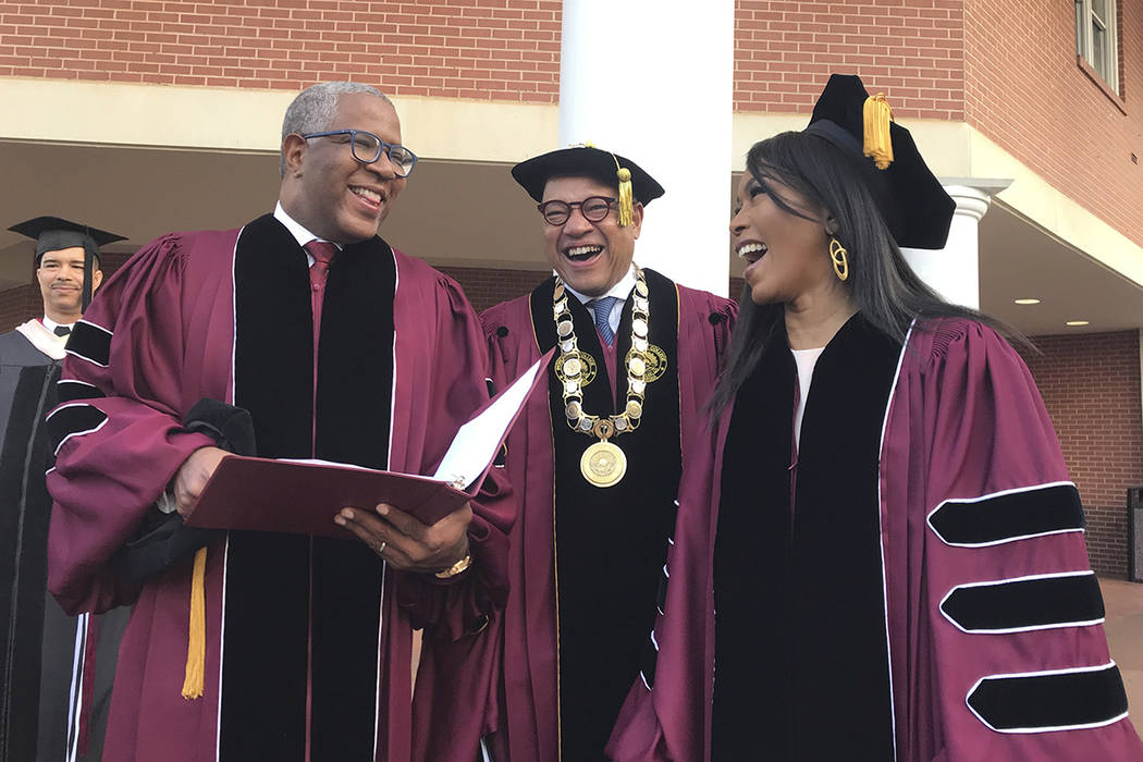 Robert F. Smith, left, laughs with David Thomas, center, and actress Angela Bassett at Morehous ...