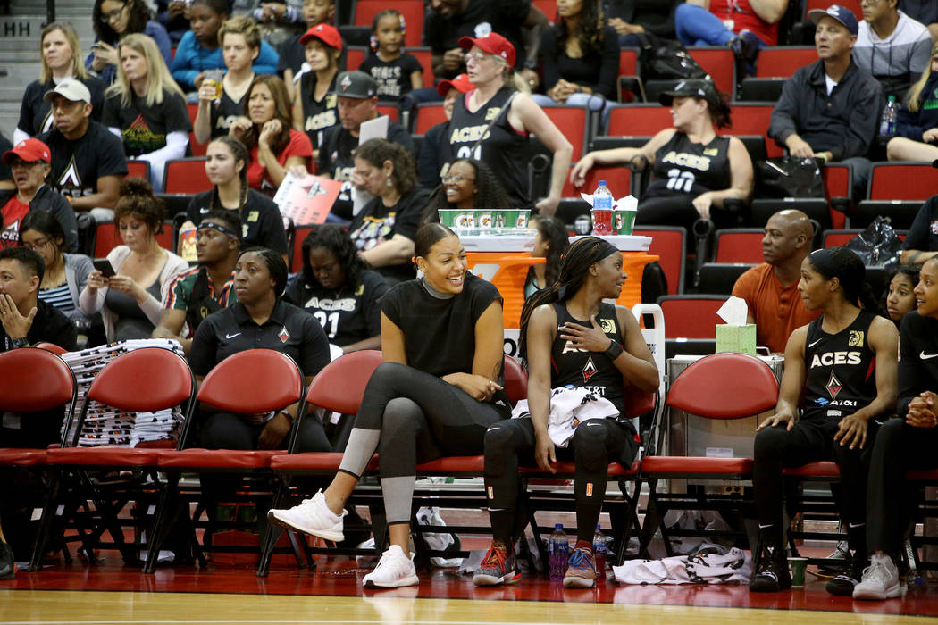 Liz Cambage, who was recently traded to the Aces from the Dallas Wings, watches the preseason g ...