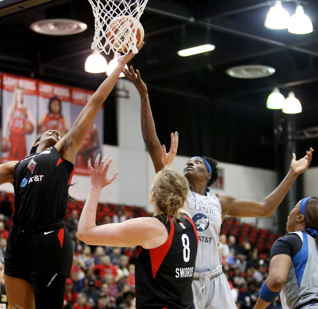 Las Vegas Aces A'ja Wilson (22) tries for a basket against Minnesota Lynx Sylvia Fowles (34) at ...
