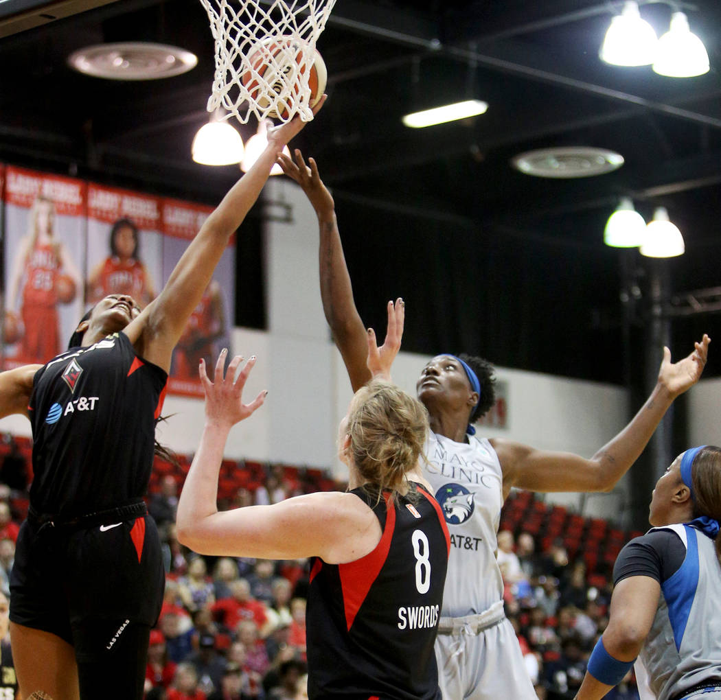 Las Vegas Aces A'ja Wilson (22) tries for a basket against Minnesota Lynx Sylvia Fowles (34) at ...