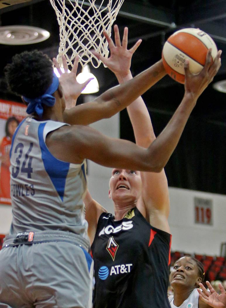 Minnesota Lynx Sylvia Fowles (34) tries a basket past Las Vegas Aces Carolyn Swords (8) at a pr ...