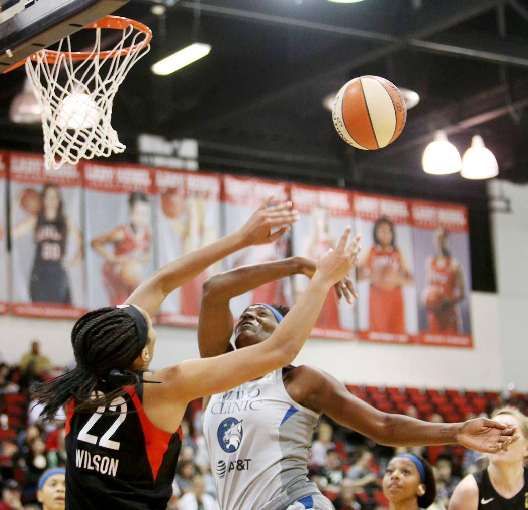 Las Vegas Aces A'ja Wilson (22) knocks the ball out of the hands of Minnesota Lynx Sylvia Fowle ...