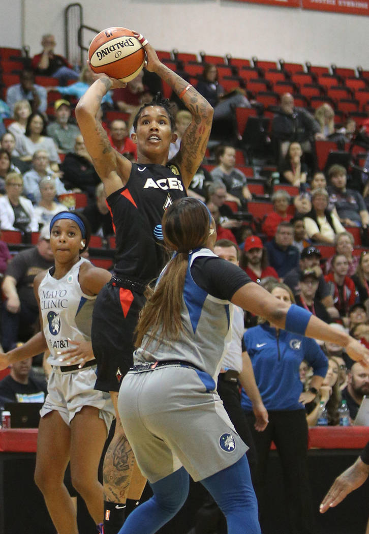 Las Vegas Aces Tamara Young (1) attempts a basket against Minnesota Lynx Odyssey Sims (1) at Co ...