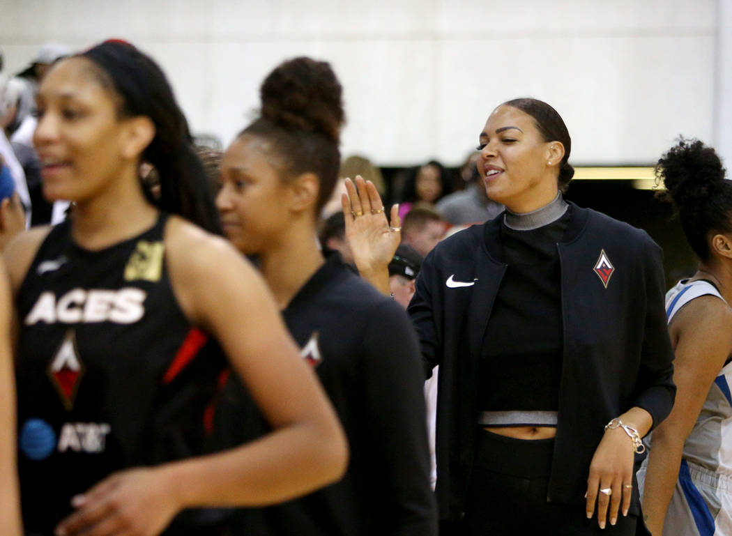 Liz Cambage, who was recently traded to the Aces from the Dallas Wings, high-fives teammates an ...