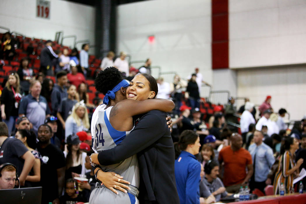 Liz Cambage, who was recently traded to the Aces from the Dallas Wings, hugs Minnesota Lynx Syl ...