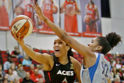 Las Vegas Aces A'ja Wilson (22) tries for a basket against Minnesota Lynx Damiris Dantas (92) a ...