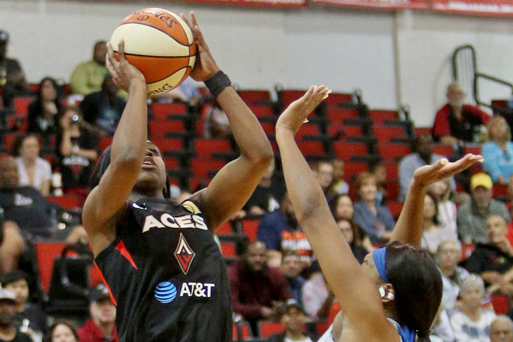 Las Vegas Aces Jackie Young (0) attempts a basket against Minnesota Lynx Odyssey Sims (1) at Co ...