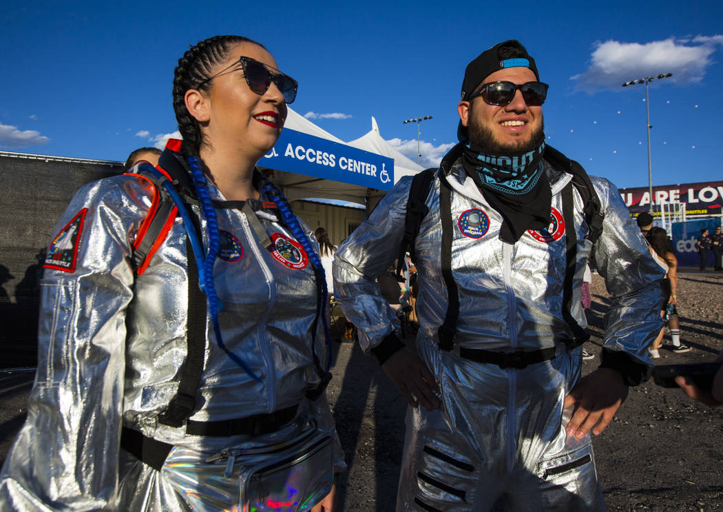 Rachel Martinez, left, and Jesse Andrade during the first day of the Electric Daisy Carnival at ...
