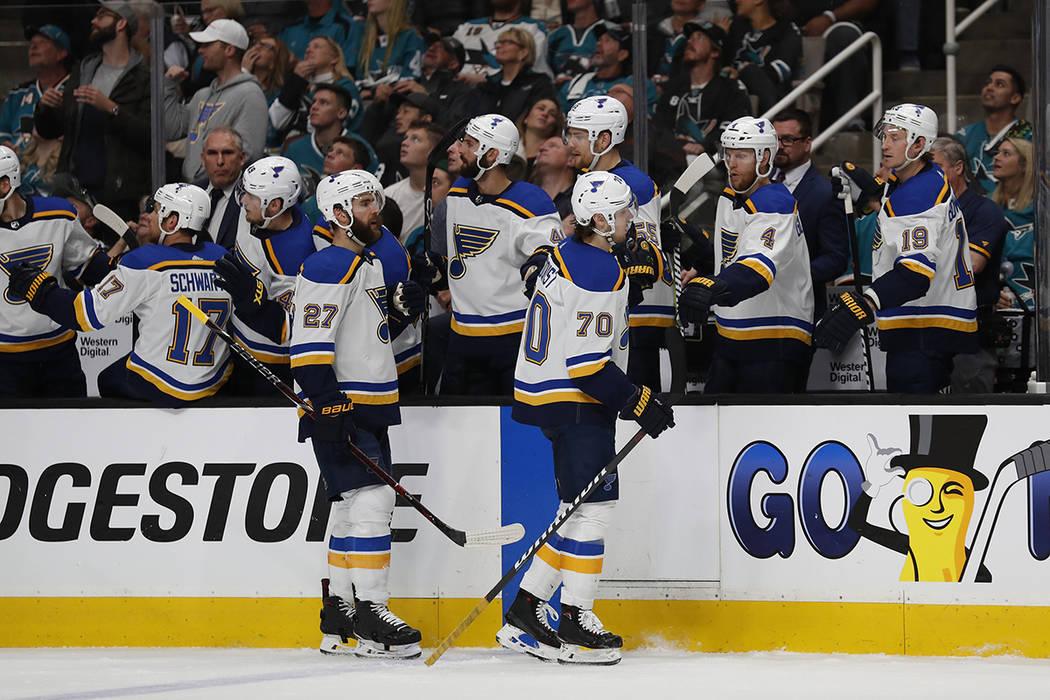 St. Louis Blues' Alex Pietrangelo (27) and Oskar Sundqvist (70) celebrate a goal against the Sa ...