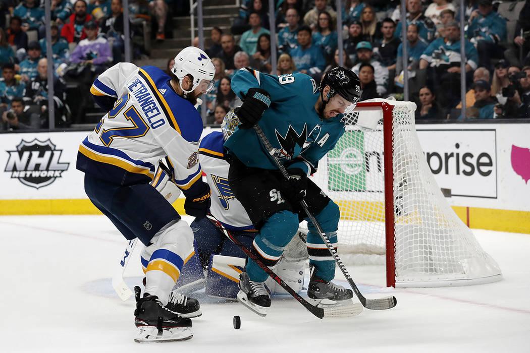 San Jose Sharks' Logan Couture (39) battles for the puck against St. Louis Blues' Alex Pietrang ...