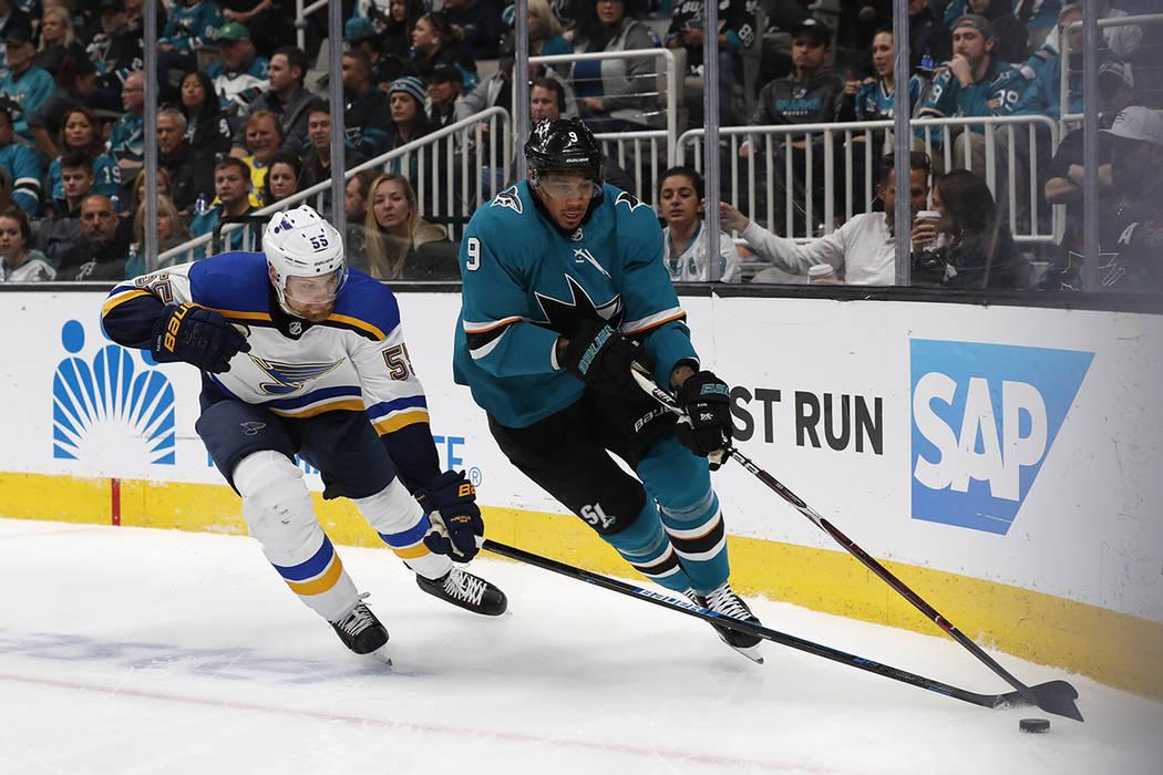 St. Louis Blues' Colton Parayko (55) battles for the puck against San Jose Sharks' Evander Kane ...