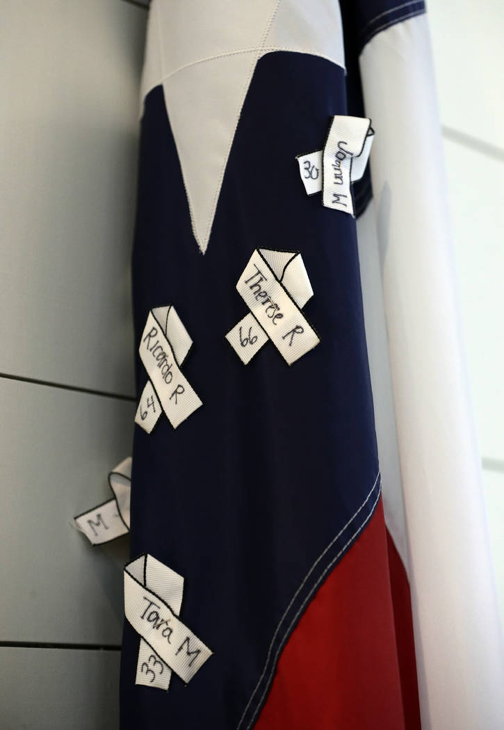 The names of victims hang on a Texas flag during a dedication ceremony for a new sanctuary and ...