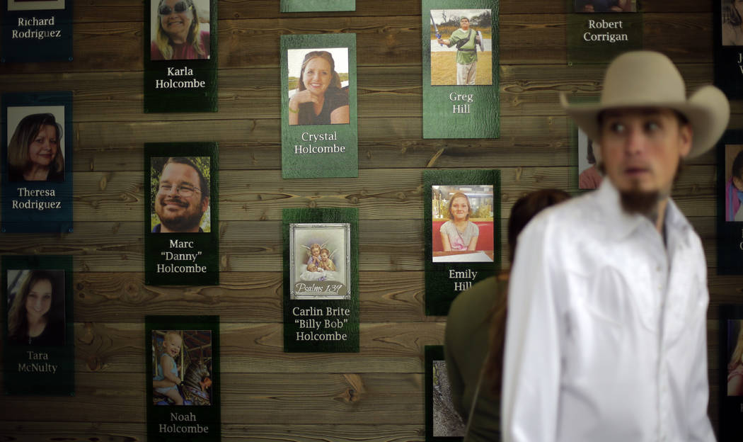 Churchgoers pass a memorial wall following a dedication ceremony for a new sanctuary and memori ...
