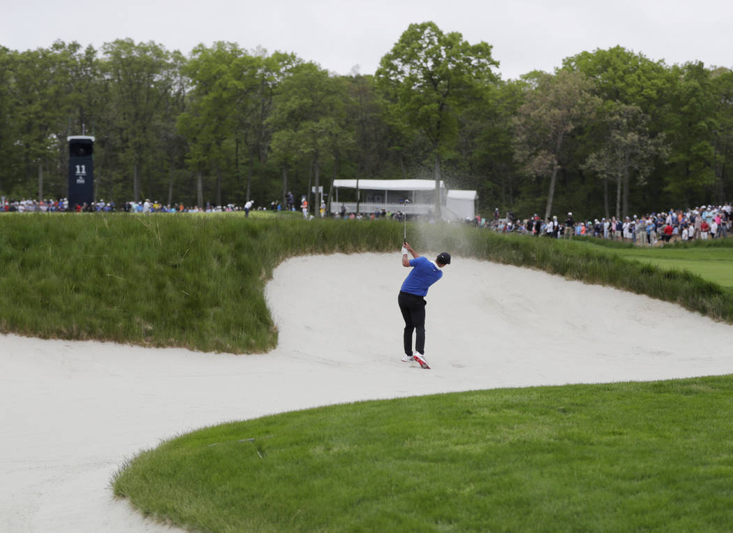 Brooks Koepka hits out of a bunker on the 11th hole during the final round of the PGA Champions ...