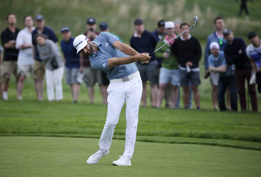 Dustin Johnson hits off the 17th fairway during the final round of the PGA Championship golf to ...