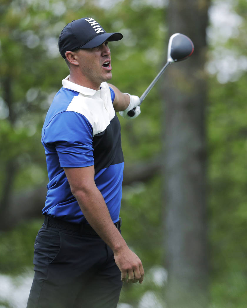 Brook Koepka reacts to his shot off the 12th tee during the final round of the PGA Championship ...