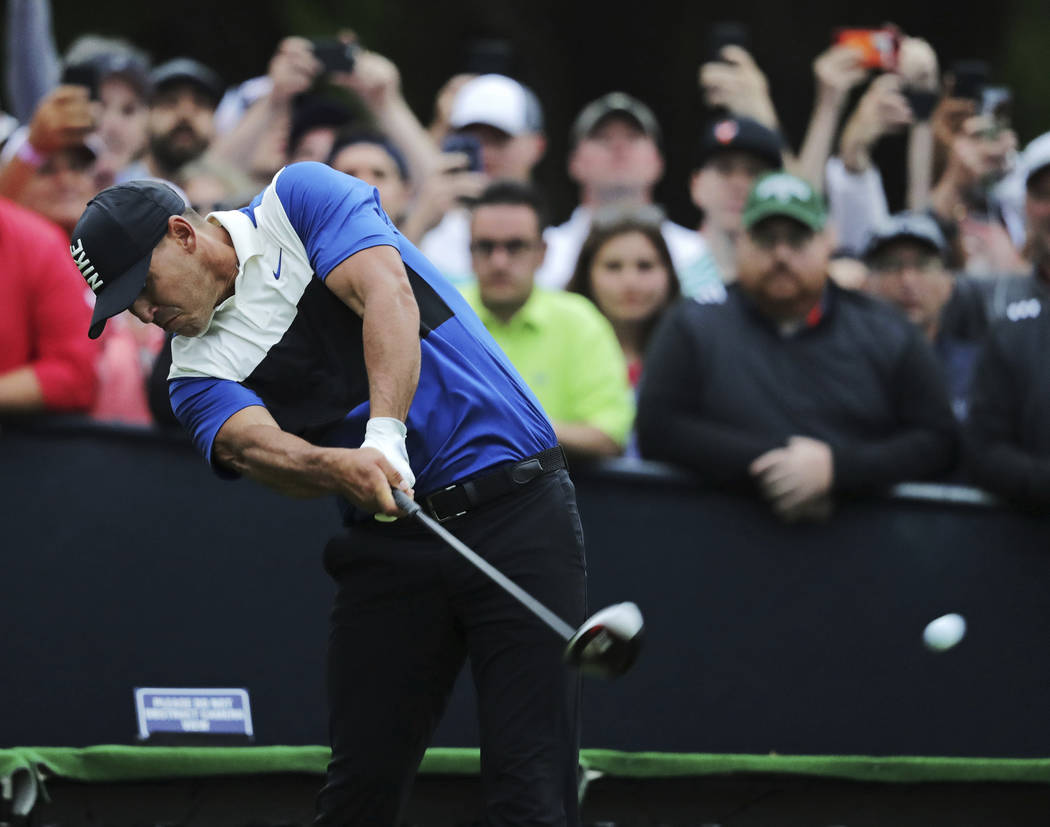 Brooks Koepka hits off the 16th tee during the final round of the PGA Championship golf tournam ...