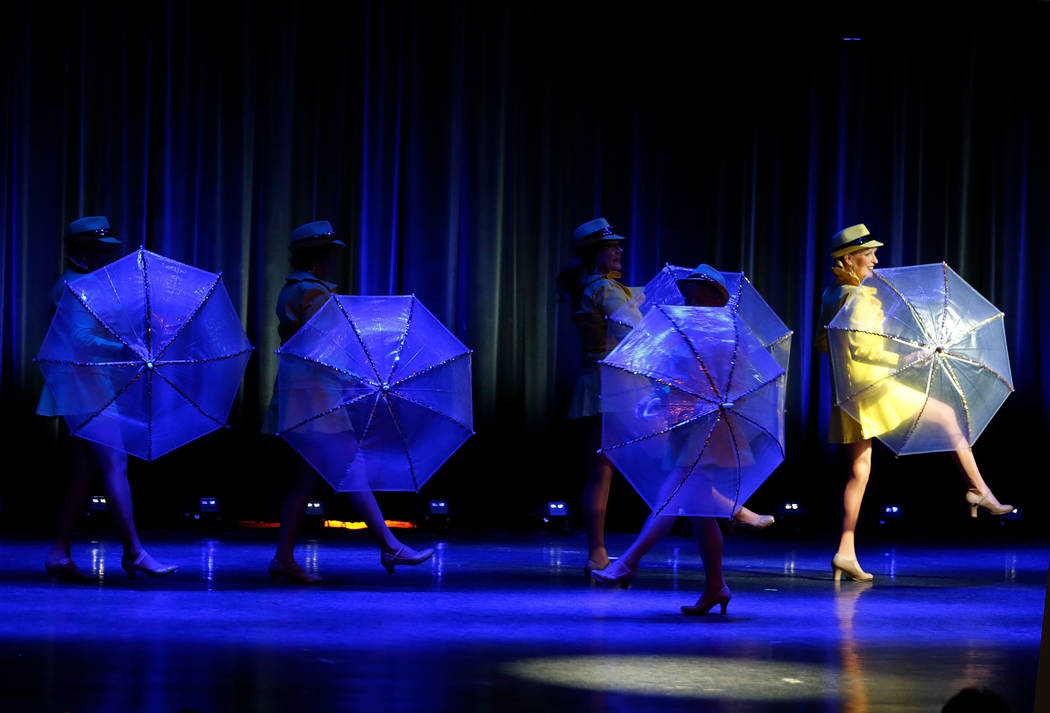 """Dancers from Sun City Dance Company perform """" It's Raining Men"""" during the Hollywood Lights sho ..."""