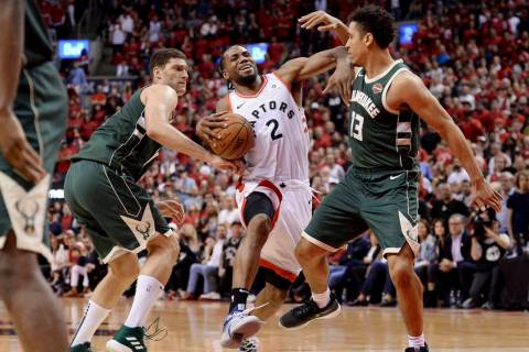 Toronto Raptors forward Kawhi Leonard (2) drives to the net against Milwaukee Bucks center Broo ...