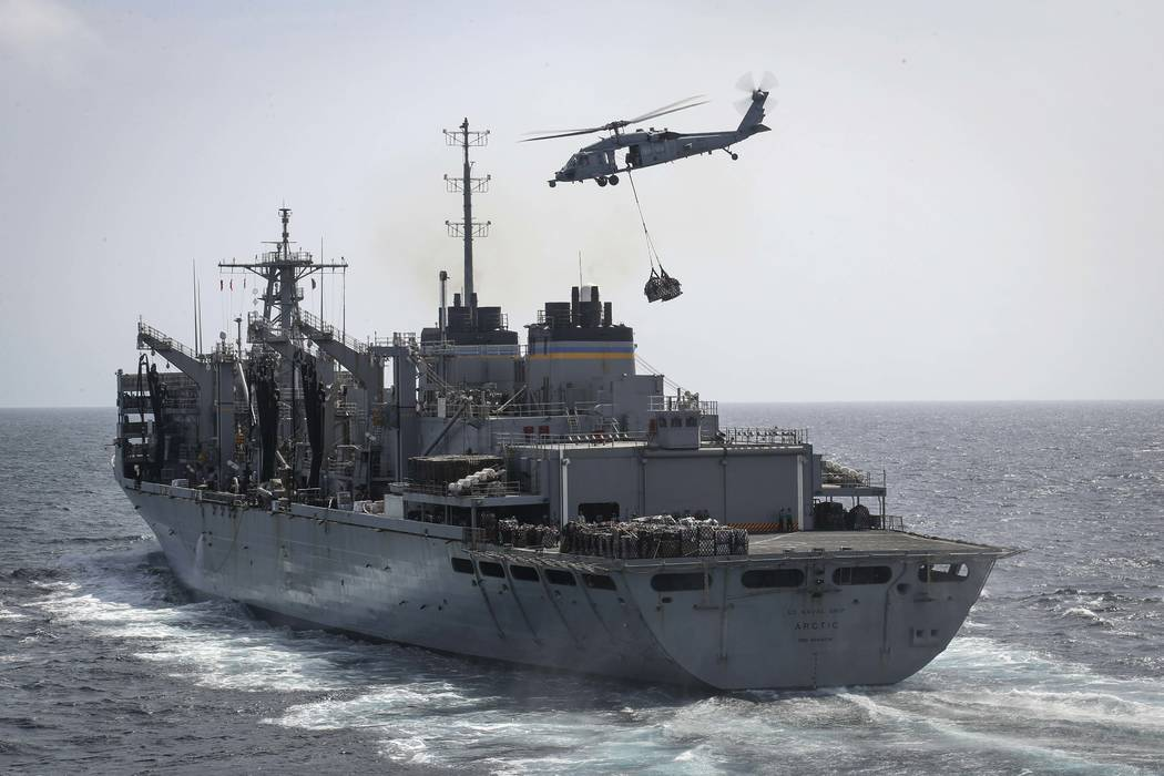 In this Sunday, May 19, 2019, photo released by the U.S. Navy, an MH-60S Sea Hawk helicopter fr ...