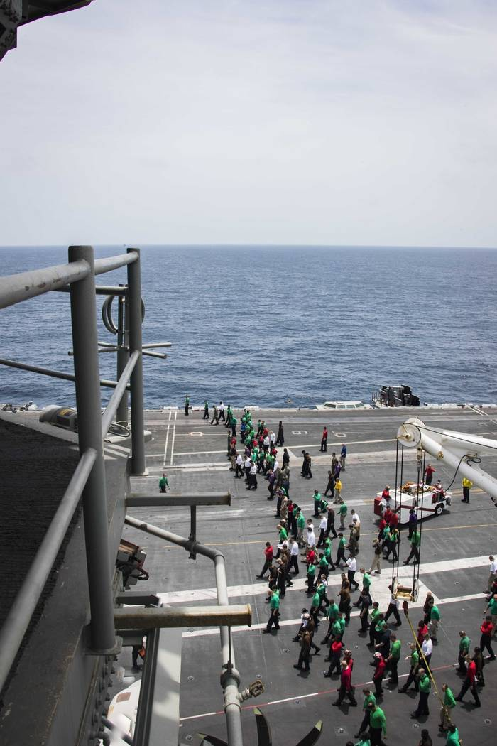 ADDS LOCATION - In this Sunday, May 19, 2019, photo released by the U.S. Navy, sailors partake ...