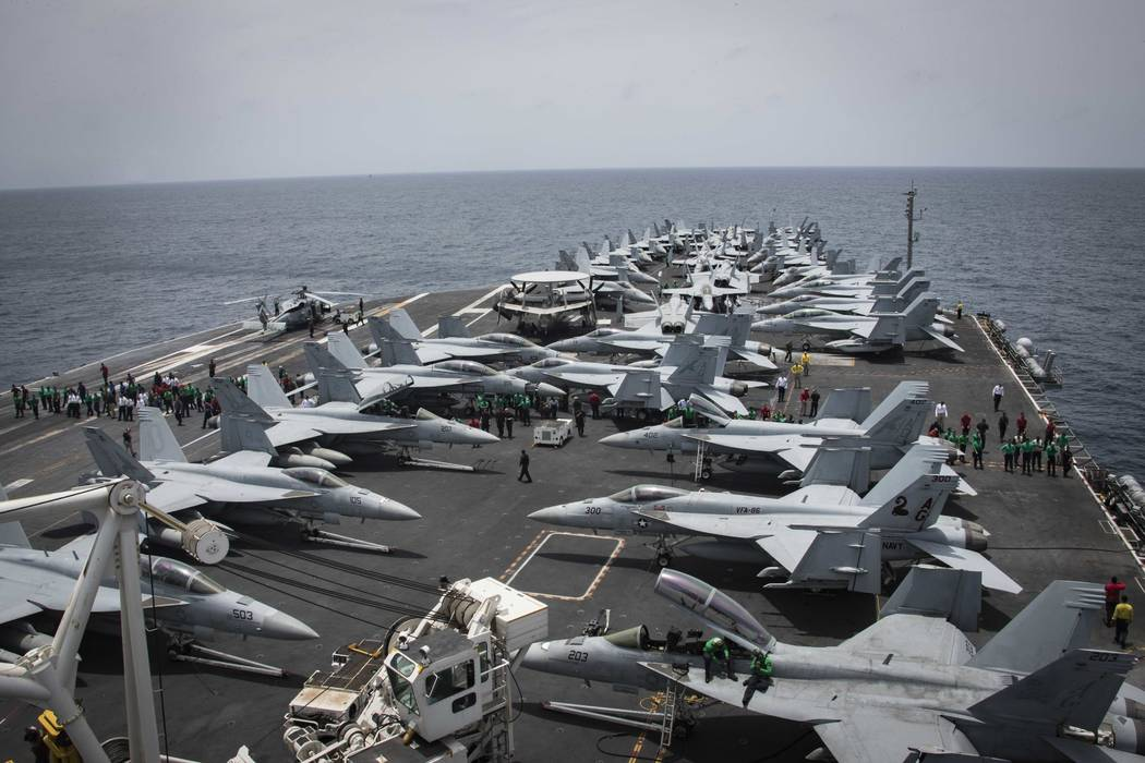 U.S. Navy, sailors partake in a foreign object and debris walk-down Sunday, May 19, 2019, on th ...
