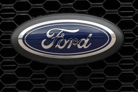 In this Feb. 17, 2019, file photo the company logo is displayed on the grille of an unsold 2019 ...