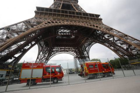 Rescue workers vehicles park just down the Eiffel Tower Monday, May 20, 2019 in Paris. The Eiff ...