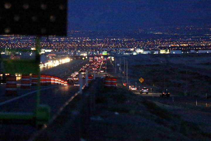 Thousands of EDC attendees leave the festival grounds at the Las Vegas Motor Speedway on Monday ...