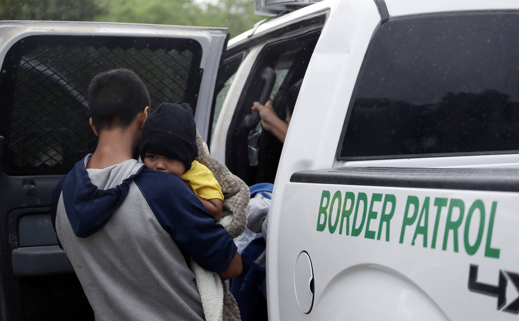 In a March 14, 2019, file photo, families who crossed the nearby U.S.-Mexico border near McAlle ...