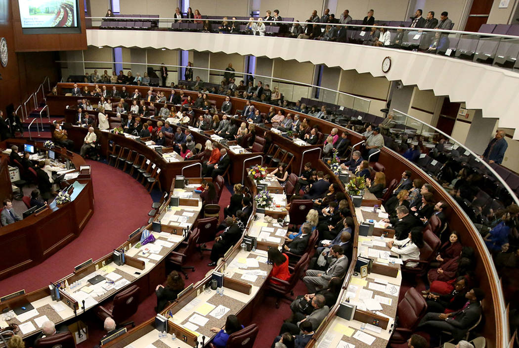 Lawmakers are seen in the Legislative Building in Carson City on the first day of the 80th sess ...