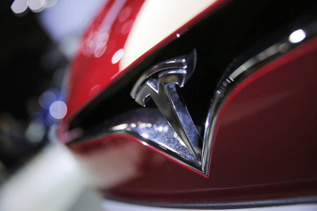 A Sept. 30, 2016, file photo shows the logo of the Tesla model S at the Paris Auto Show in Pari ...