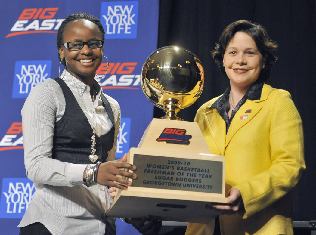 Georgetown's Sugar Rodgers, left, accepts the Big East women's basketball Freshman of the Year ...