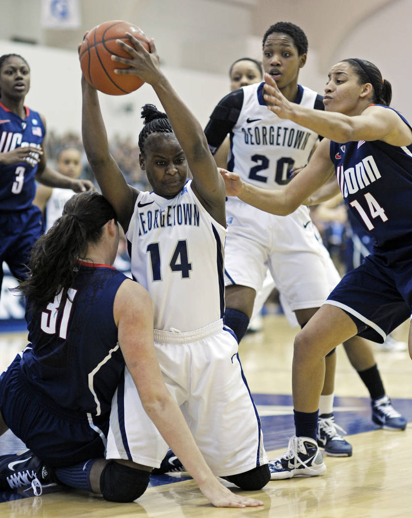 Georgetown guard Sugar Rodgers, 14, takes the ball away from Connecticut center Stefanie Dolson ...
