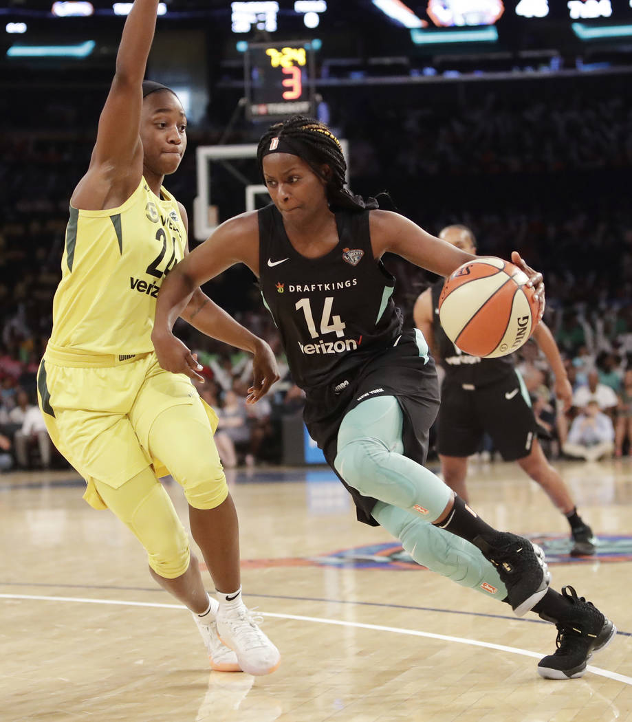 Seattle Storm's Jewell Loyd, left, defends against New York Liberty's Sugar Rodgers in the thir ...
