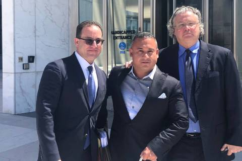 David Oancea, known in sports betting circles as Vegas Dave, center, stands with attorneys Rich ...