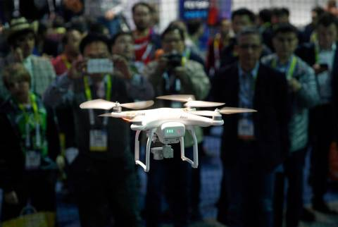 A drone hovers at the DJI booth during CES International in Las Vegas on Jan. 7, 2016. In Utah, ...