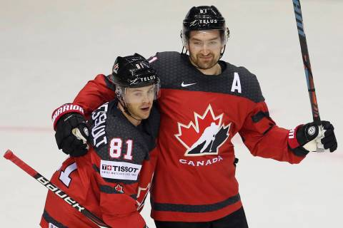 Canada's Mark Stone, right, celebrates with Canada's Jonathan Marchessault, left, after scoring ...