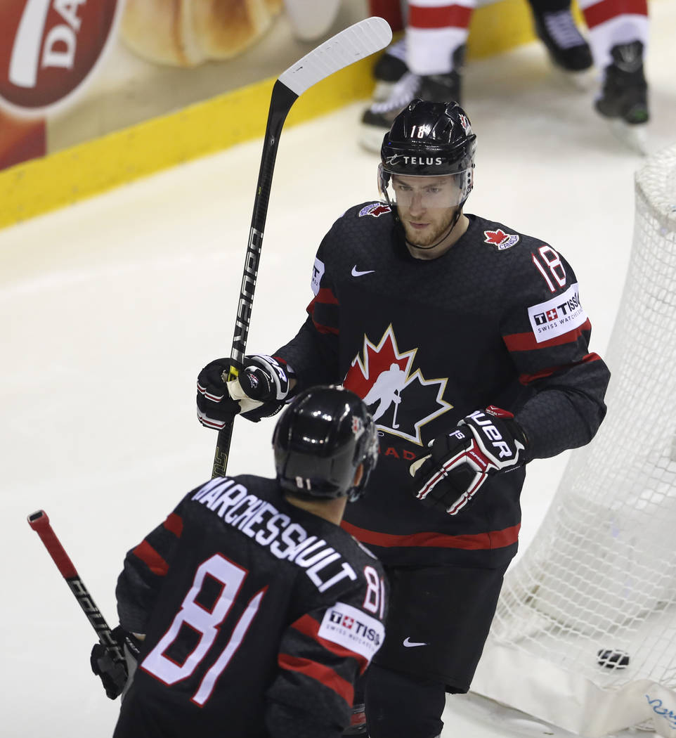 Canada's Pierre-Luc Dubois, right, celebrates with Canada's Jonathan Marchessault, left, after ...