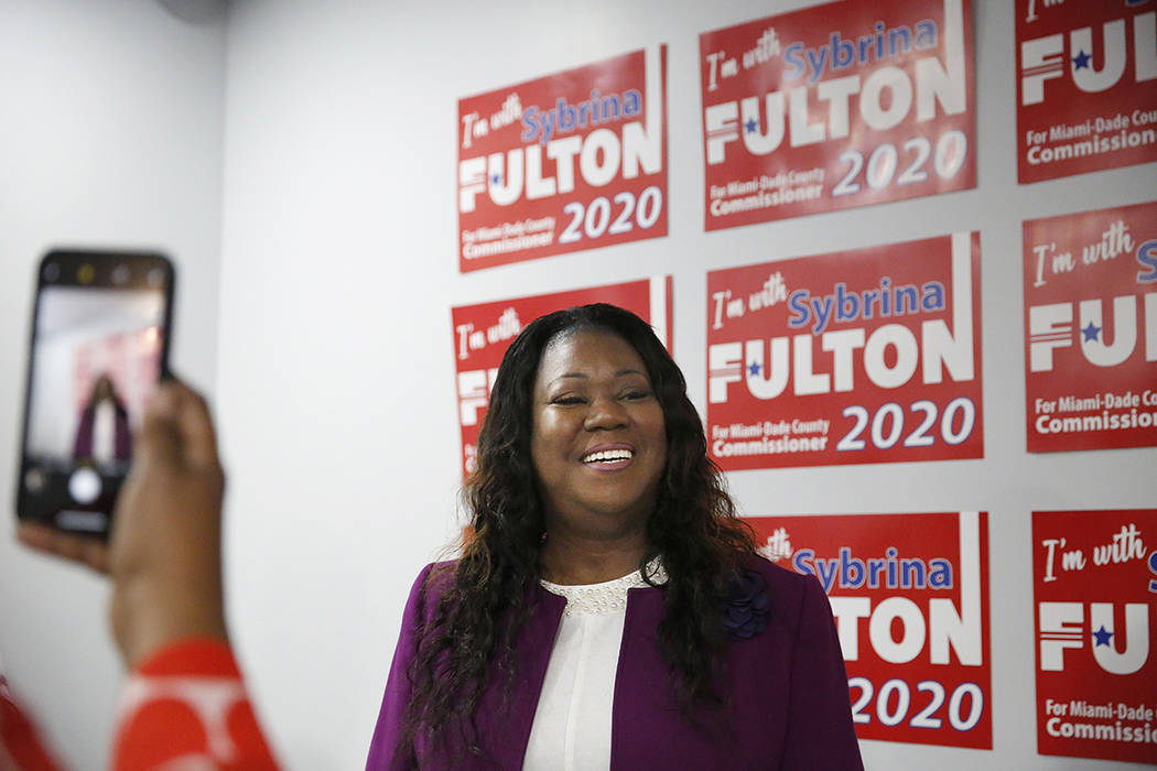 A supporter takes a photograph of Sybrina Fulton after she announced her run for the District 1 ...