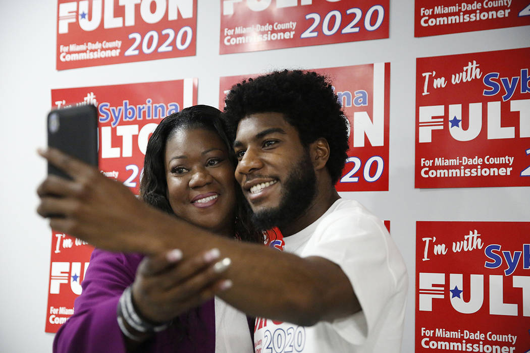 Sybrina Fulton, left, takes a photograph with her son, Jahvaris Fulton, right, after announcing ...